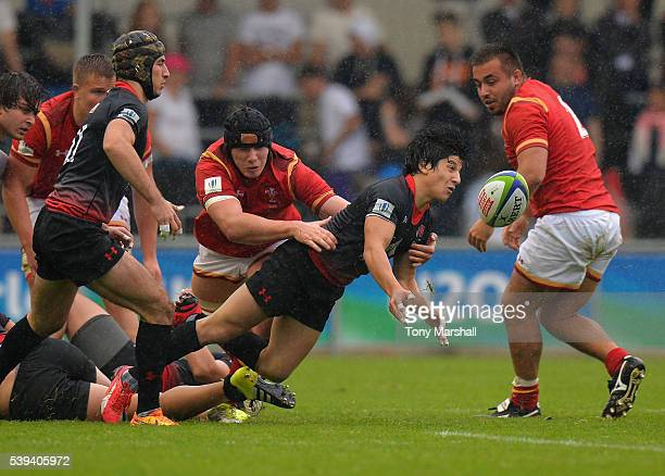Seb Davies of Wales tackles Gela Aprasidze of Georgia during the World Rugby U20 Championship match between Wales and Georgia at The Academy Stadium...