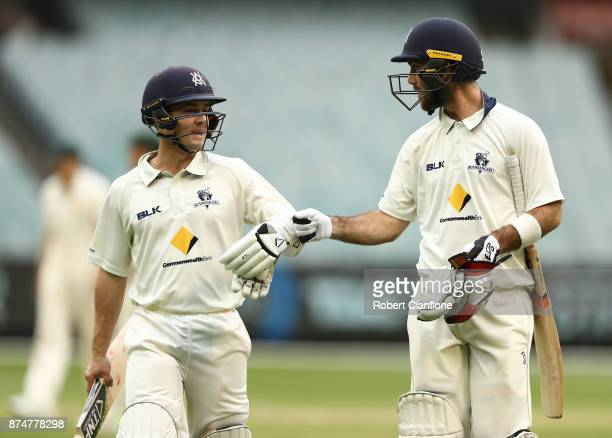 Seb Gotch and Glenn Maxwell of Victoria walk off after bad light stopped play during day four of the Sheffield Shield match between Victoria and...