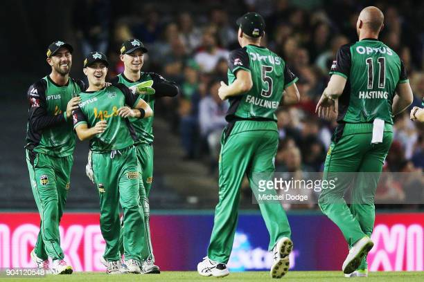 Seb Gotch of the Stars celebrates catch with Glenn Maxwell of the Stars and Peter Handscomb during the Big Bash League match between the Melbourne...