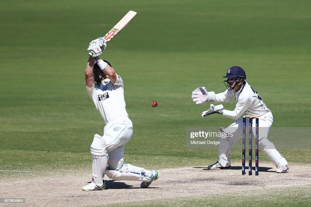 Seb Gotch of Victoria stumps Peter Neville of New South Wales to win during day five of the Sheffield Shield match between Victoria and New South Wales at Junction Oval on March 6, 2018 in Melbourne, Australia.