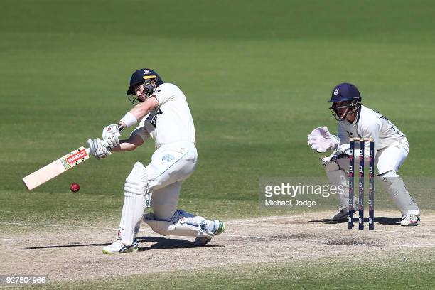Seb Gotch of Victoria stumps Peter Neville of New South Wales to win during day five of the Sheffield Shield match between Victoria and New South...