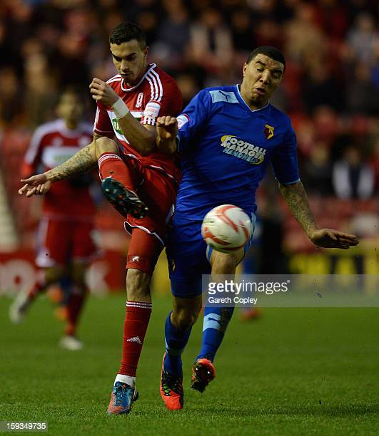 Seb Hines of Middlesborough is tackled by Troy Deeney of Watford during the npower Championship match between Middlesbrough and Watford at Riverside...