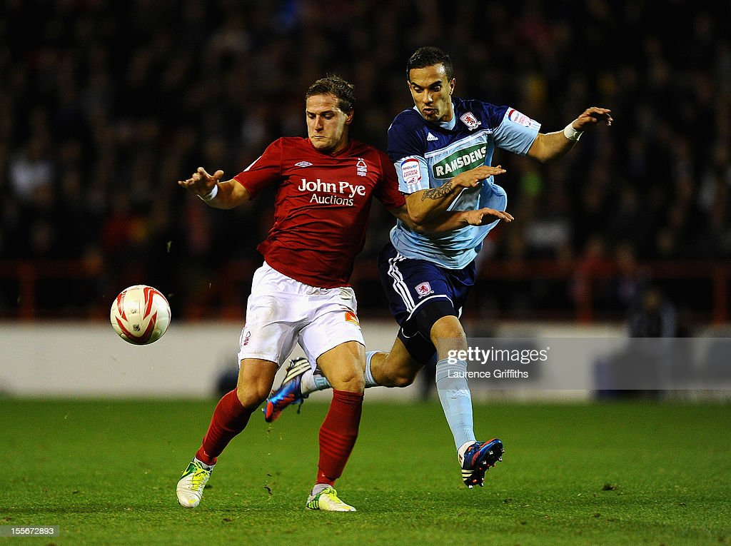 Seb Hines of Middlesbrough battles with Billy Sharp of Nottingham Forest during the npower Championship match between Nottingham Forest and Middlesbrough at the City Ground on November 6, 2012 in Nottingham, England.