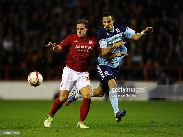 Seb Hines of Middlesbrough battles with Billy Sharp of Nottingham Forest during the npower Championship match between Nottingham Forest and...