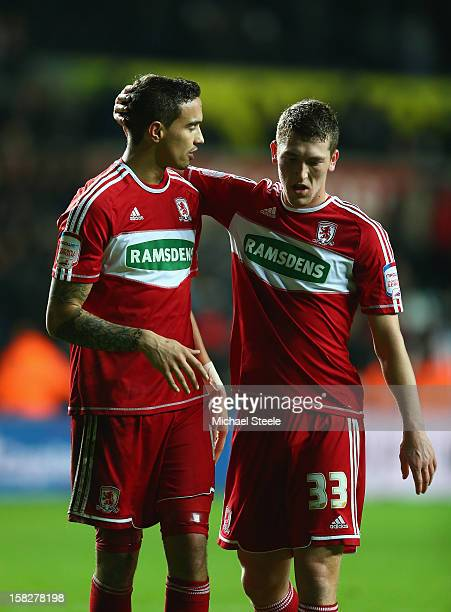 Seb Hines of Middlesbrough scorer of an own goal in his sides 01 defeat is consoled on the final whistle by team mate Richard Smallwood l during the...