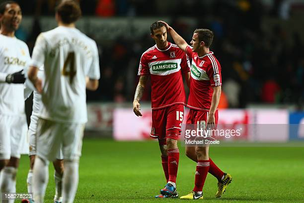 Seb Hines of Middlesbrough scorer of an own goal in his sides 0-1 defeat is consoled on the final whistle by team mate Andrew Halliday during the...
