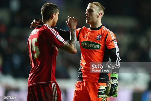 Seb Hines of Middlesbrough scorer of an own goal in his sides 0-1 defeat is consoled on the final whistle by team mate Jason Steele during the...