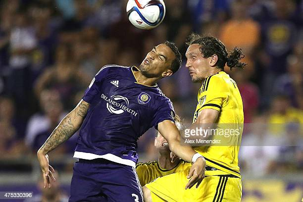 Seb Hines of Orlando City SC and Emanuel Pogatetz of Columbus Crew fight to head the ball during a MLS soccer match between the Columbus Crew and the...