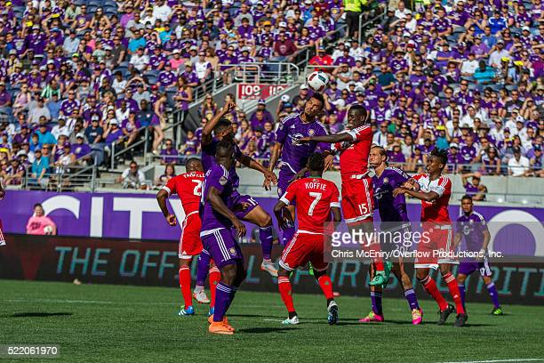 Seb Hines of the Orlando City Lions jumps for the ball against New England Revolution at the Citrus Bowl in Orlando, Florida on April 17, 2016.
