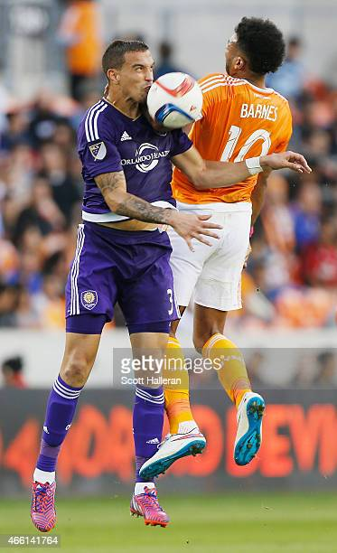 Seb Hines of the Orlando City SC battles for the ball with Giles Barnes of the Houston Dynamo during their game at BBVA Compass Stadium on March 13,...