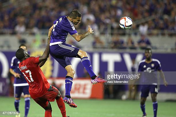 Seb Hines of the Orlando City SC heads the ball in front of Jozy Altidore of Toronto FC during an MLS soccer match between Toronto FC and the Orlando...