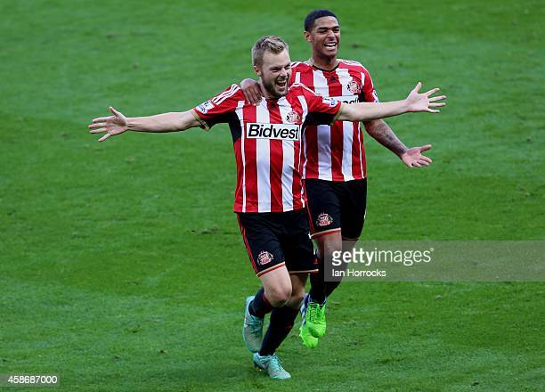 Seb Larrson of Sunderland celebrates after scoring the opening goal with a free kick during the Barclays Premier League match between Sunderland and...
