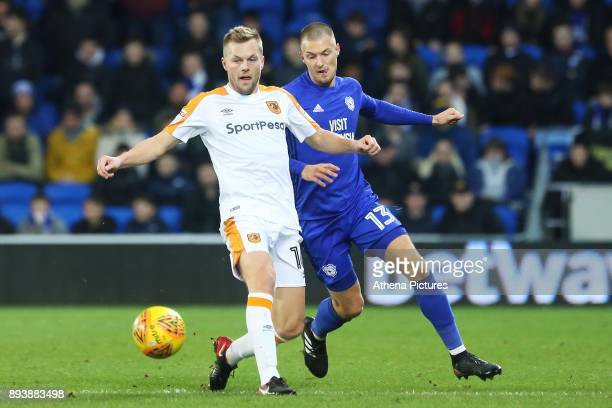 Seb Larsson of Hull City is marked by Anthony Pilkington of Cardiff City during the Sky Bet Championship match between Cardiff City and Hull City at...