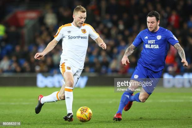 Seb Larsson of Hull City is marked by Lee Tomlin of Cardiff City during the Sky Bet Championship match between Cardiff City and Hull City at the...