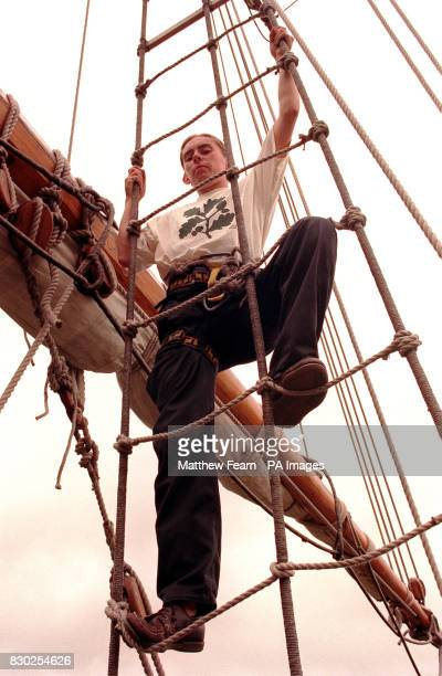 Seb Ward from Accrington professional sailor and bosun of the Grand Turk climbs it's rigging in London during a preview of the National Trust's coast...