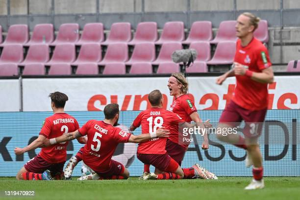 Sebastiaan Bornauw of 1.FC Koeln celebrates after scoring their team's first goal with his team mates during the Bundesliga match between 1. FC Koeln...