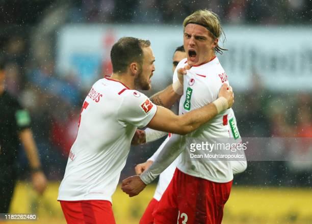 Sebastiaan Bornauw of FC Koln celebrates after scoring his sides third goal during the Bundesliga match between 1. FC Koeln and SC Paderborn 07 at...