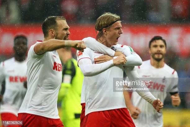 Sebastiaan Bornauw of FC Koln celebrates after scoring his sides third goal during the Bundesliga match between 1 FC Koeln and SC Paderborn 07 at...