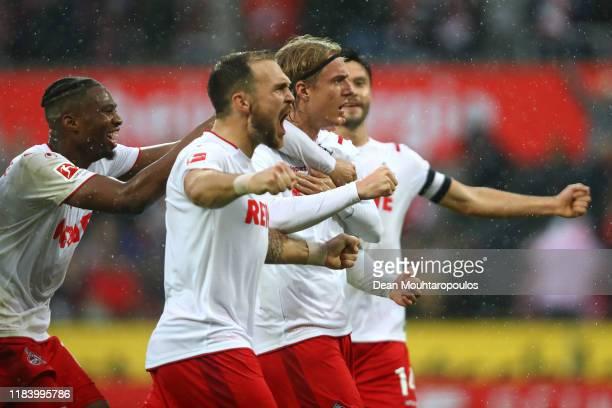 Sebastiaan Bornauw of FC Koln celebrates scoring his teams third goal of the game with team mates during the Bundesliga match between 1 FC Koeln and...
