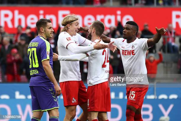 Sebastiaan Bornauw of FC Koln celebrates with his teammates after scoring his sides first goal during the Bundesliga match between 1. FC Koeln and...