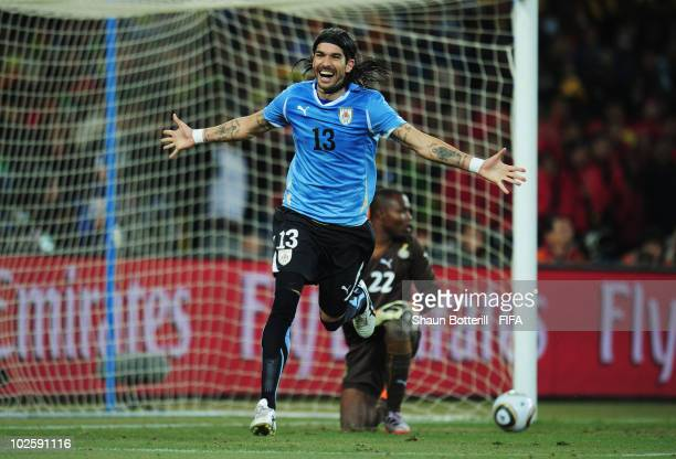 Sebastian Abreu of Uruguay celebrates after he chips the final penalty kick straight down the middle of the goal past Richard Kingson of Ghana during...