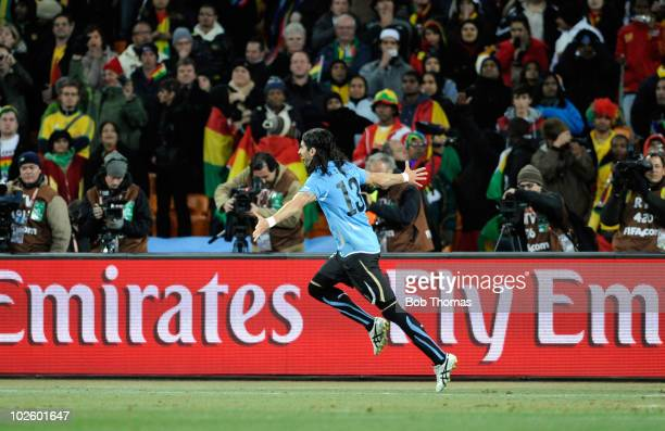 Sebastian Abreu of Uruguay celebrates after scoring the winning penalty during the 2010 FIFA World Cup South Africa Quarter Final match between...