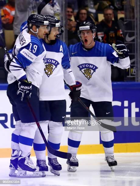 Sebastian Aho of Finland celebrate with Veli Matti Savinainen and Julius Honka after he scores the opening goal during the 2018 IIHF Ice Hockey World...