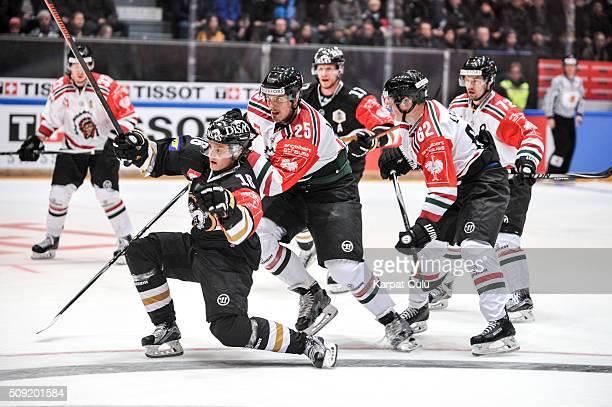 Sebastian Aho of Karpat Oulu reaching for the puck while Oliver Lauridsen and Artturi Lehkonen of Frolunda Gothenburg defending during the Champions...