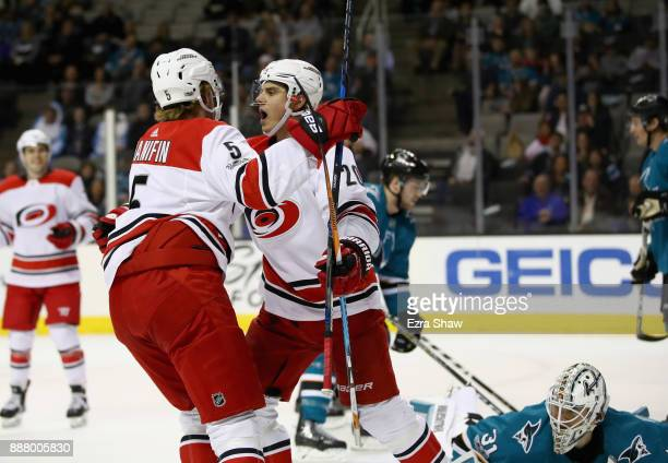 Sebastian Aho of the Carolina Hurricanes and Noah Hanifin celebrate after Aho scored on Martin Jones of the San Jose Sharks in the first period at...