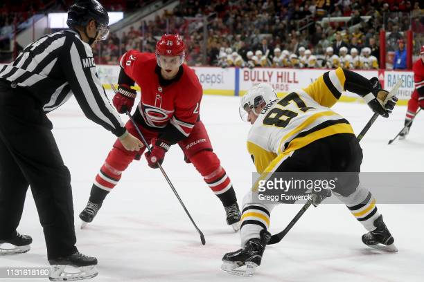 Sebastian Aho of the Carolina Hurricanes and Sidney Crosby of the Pittsburgh Penguins meet in a faceoff during an NHL game on March 19 2019 at PNC...