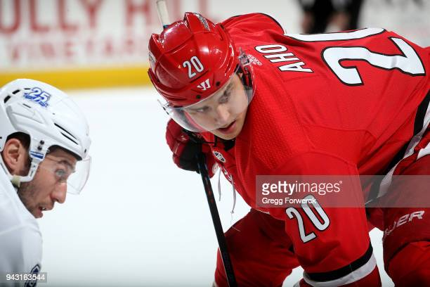 Sebastian Aho of the Carolina Hurricanes and Tyler Johnson of the Tampa Bay Lightning prepare for a faceoff during an NHL game on April 7 2018 at PNC...