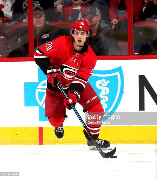 Sebastian Aho of the Carolina Hurricanes carries the puck during an NHL game against the New York Islanders on February 16 2018 at PNC Arena in...