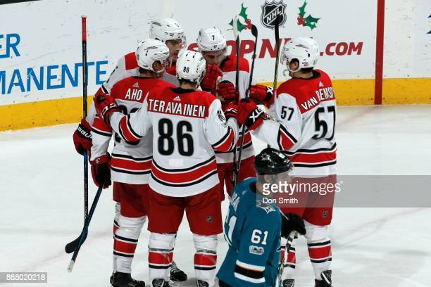 Sebastian Aho of the Carolina Hurricanes celebrates his first period goal against the San Jose Sharks with teammates at SAP Center on December 7 2017...