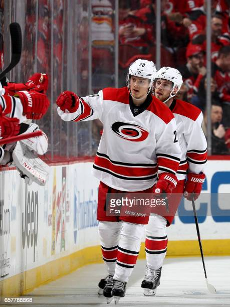 Sebastian Aho of the Carolina Hurricanes celebrates his goal with teammates on the bench in the second period against the New Jersey Devils on March...