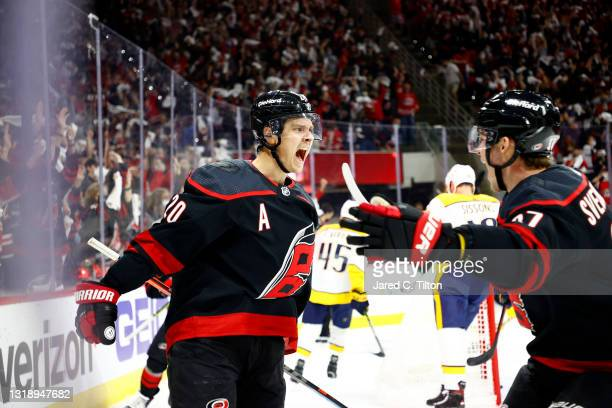 Sebastian Aho of the Carolina Hurricanes celebrates with teammate Andrei Svechnikov following a goal scored during the first period in Game Two of...