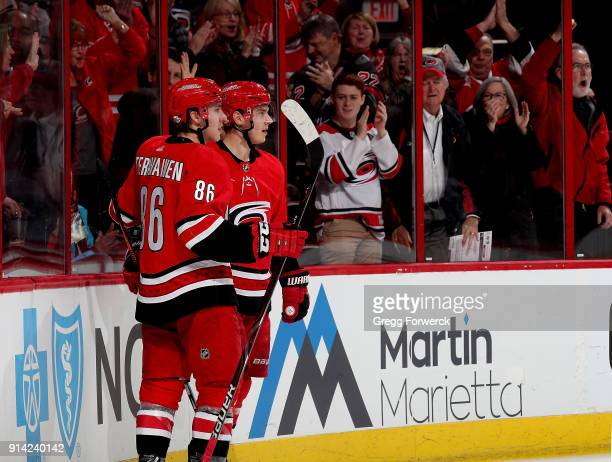 Sebastian Aho of the Carolina Hurricanes celebrates with teammate Teuvo Teravainen after scoring a goal during an NHL game against the San Jose...