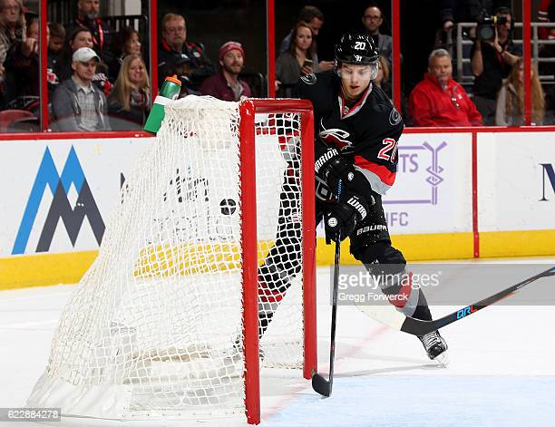 Sebastian Aho of the Carolina Hurricanes chips a puck into an empty net scoring his second goal of the game during an NHL game against the Washington...