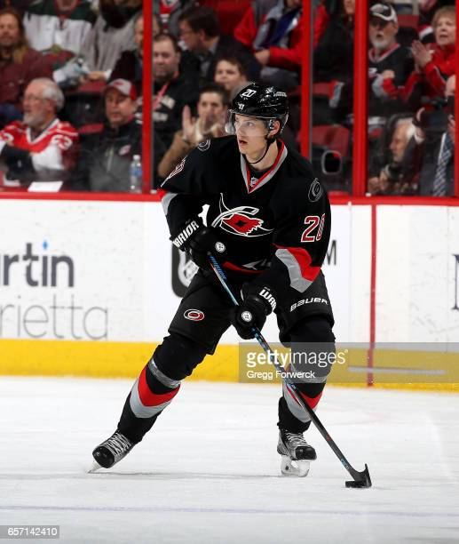 Sebastian Aho of the Carolina Hurricanes controls a puck on the ice during an NHL game against the Minnesota Wild on March 16 2017 at PNC Arena in...
