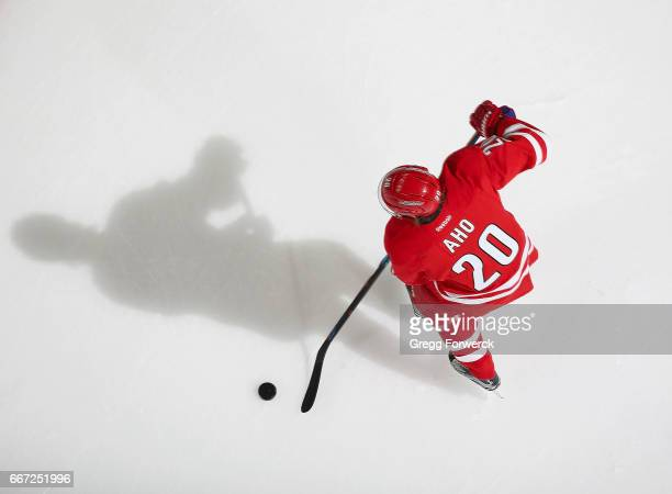 Sebastian Aho of the Carolina Hurricanes controls the puck on the ice during an NHL game against the St Louis Blues on April 8 2017 at PNC Arena in...