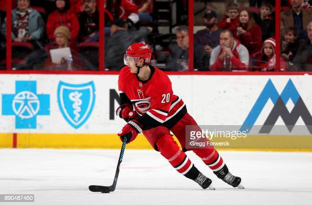 Sebastian Aho of the Carolina Hurricanes controls the puck on the ice during an NHL game against the Florida Panthers on December 3 2017 at PNC Arena...
