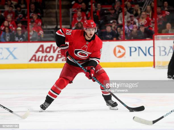 Sebastian Aho of the Carolina Hurricanes controls the puck on the ice during an NHL game against the Winnipeg Jets on March 4 2018 at PNC Arena in...