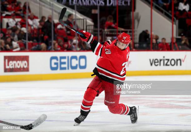 Sebastian Aho of the Carolina Hurricanes fires a slap shot during an NHL game against the Florida Panthers on December 3 2017 at PNC Arena in Raleigh...