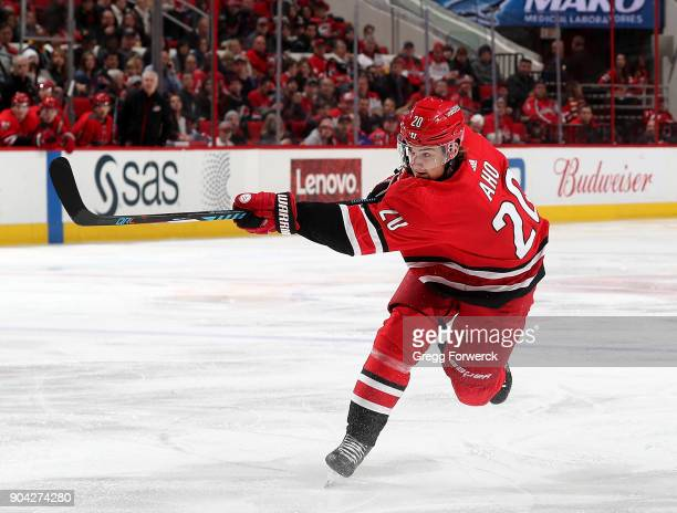 Sebastian Aho of the Carolina Hurricanes fires a slap shot during an NHL game against the Washington Capitals on January 2 2018 at PNC Arena in...