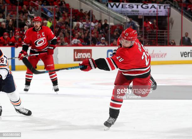 Sebastian Aho of the Carolina Hurricanes fires a slap shot on goal and scores during an NHL game against the Edmonton Oilers on March 20 2018 at PNC...