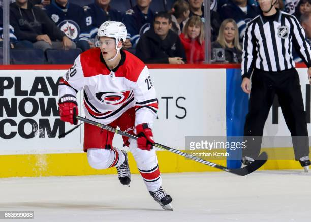 Sebastian Aho of the Carolina Hurricanes follows the play down the ice during first period action against the Winnipeg Jets at the Bell MTS Place on...