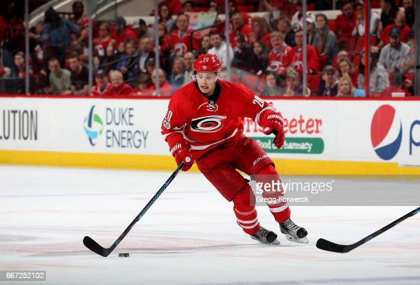 Sebastian Aho of the Carolina Hurricanes gathers up a loose puck during an NHL game against the St Louis Blues on April 8 2017 at PNC Arena in...