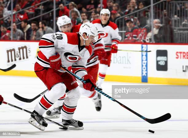Sebastian Aho of the Carolina Hurricanes heads for the net in the third period against the New Jersey Devils on March 25 2017 at Prudential Center in...