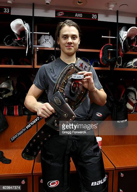 Sebastian Aho of the Carolina Hurricanes is photographed after scoring his first NHL goal and being named number one star of the game during an NHL...