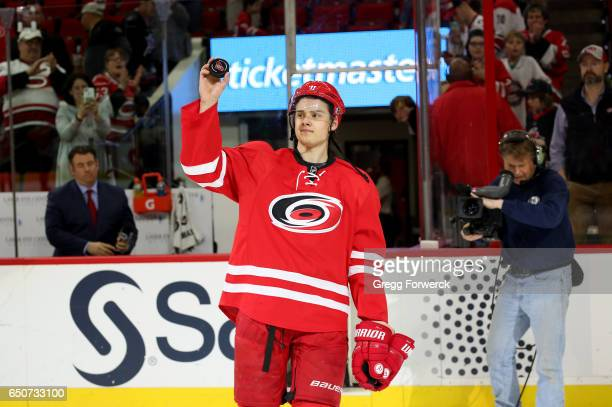 Sebastian Aho of the Carolina Hurricanes is recognized as the first star of the game following an NHL game against the New York Rangers on March 9...