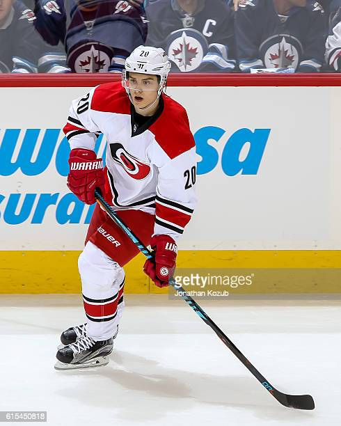 Sebastian Aho of the Carolina Hurricanes keeps an eye on the play during second period action against the Winnipeg Jets at the MTS Centre on October...